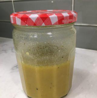 mason jar with vinaigrette inside