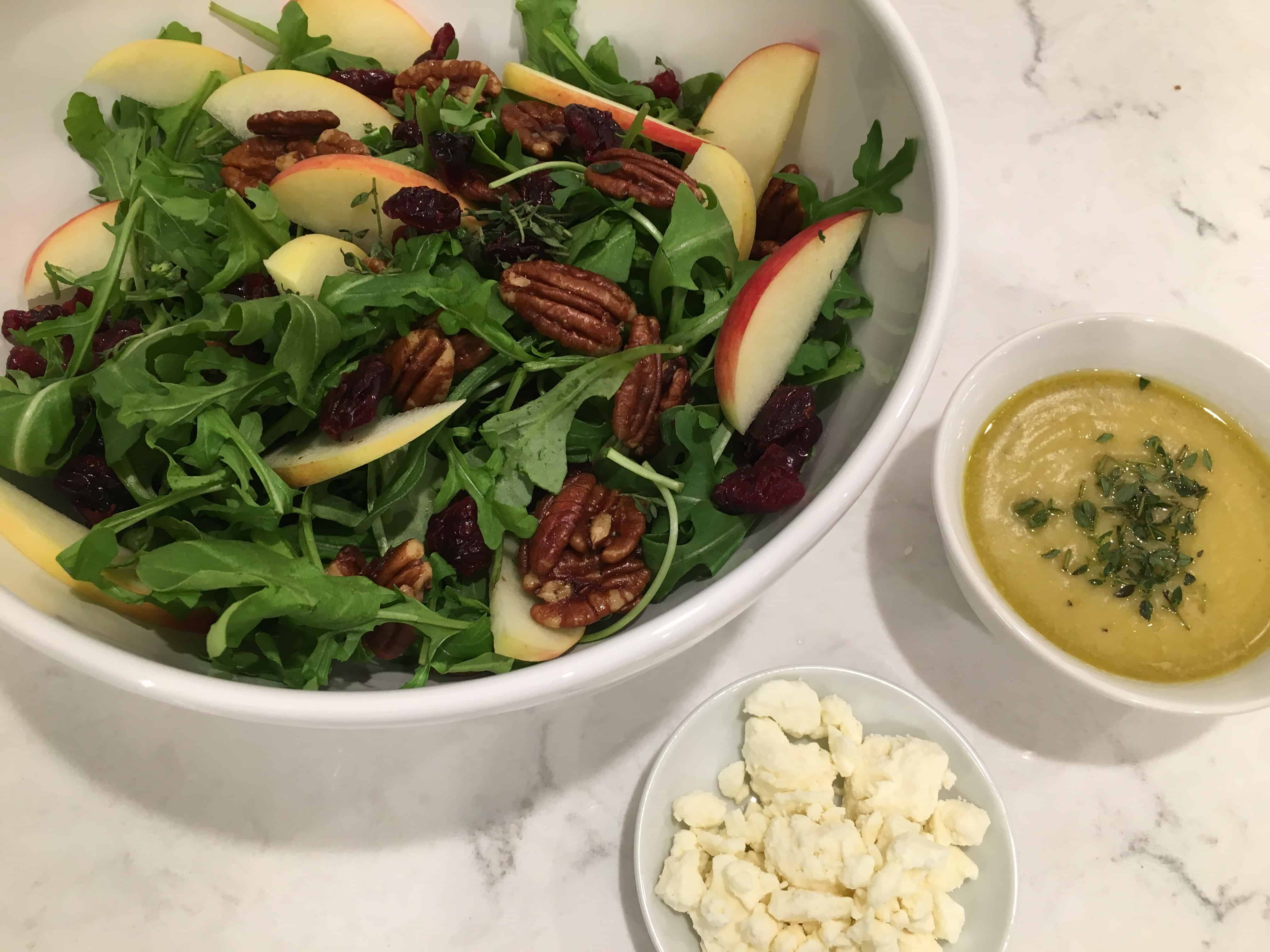 bowl of Apple and Cranberry Salad with Feta and Maple Roasted Pecans