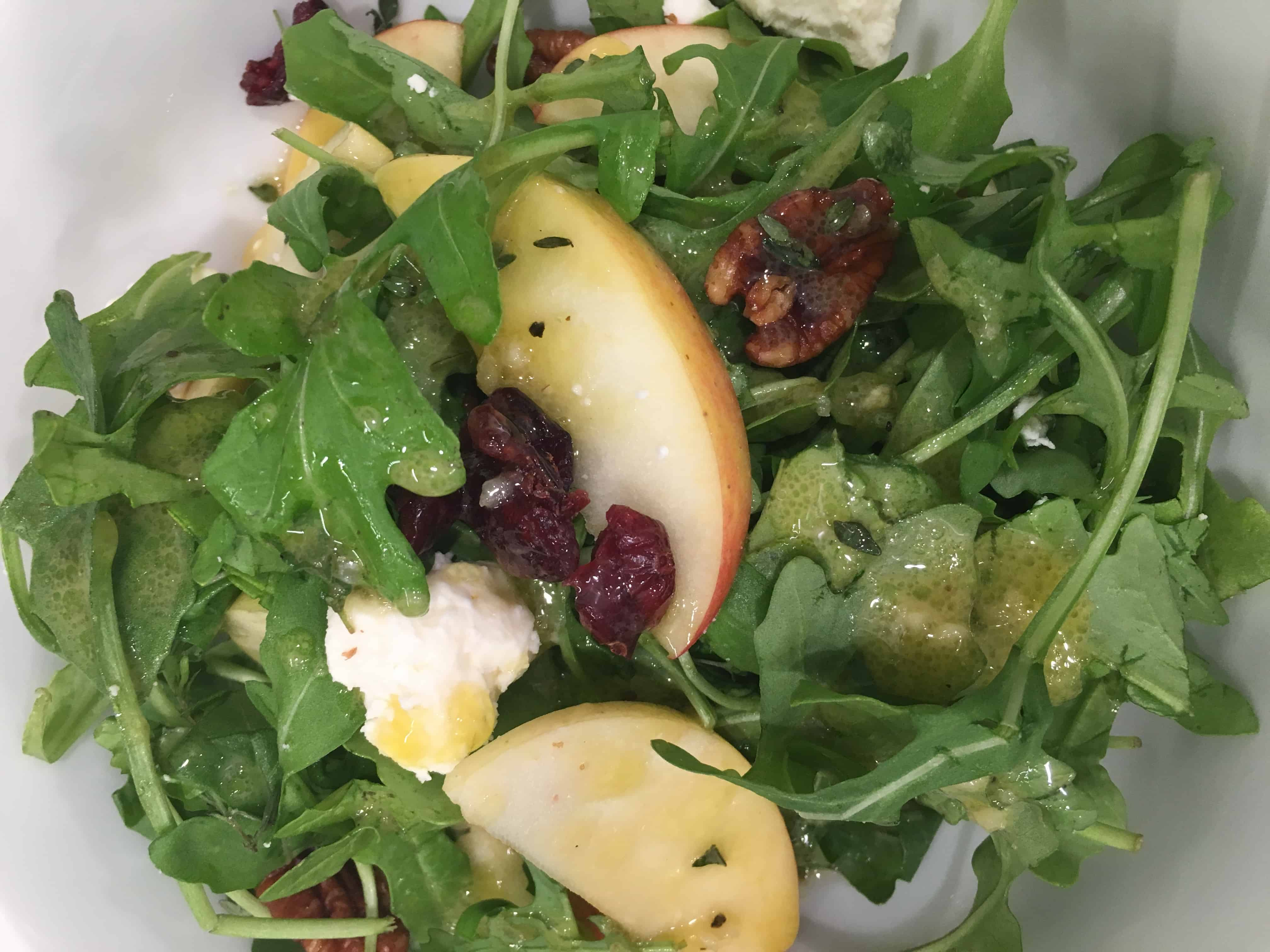 close up Apple and Cranberry Salad with Feta and Maple Roasted Pecans