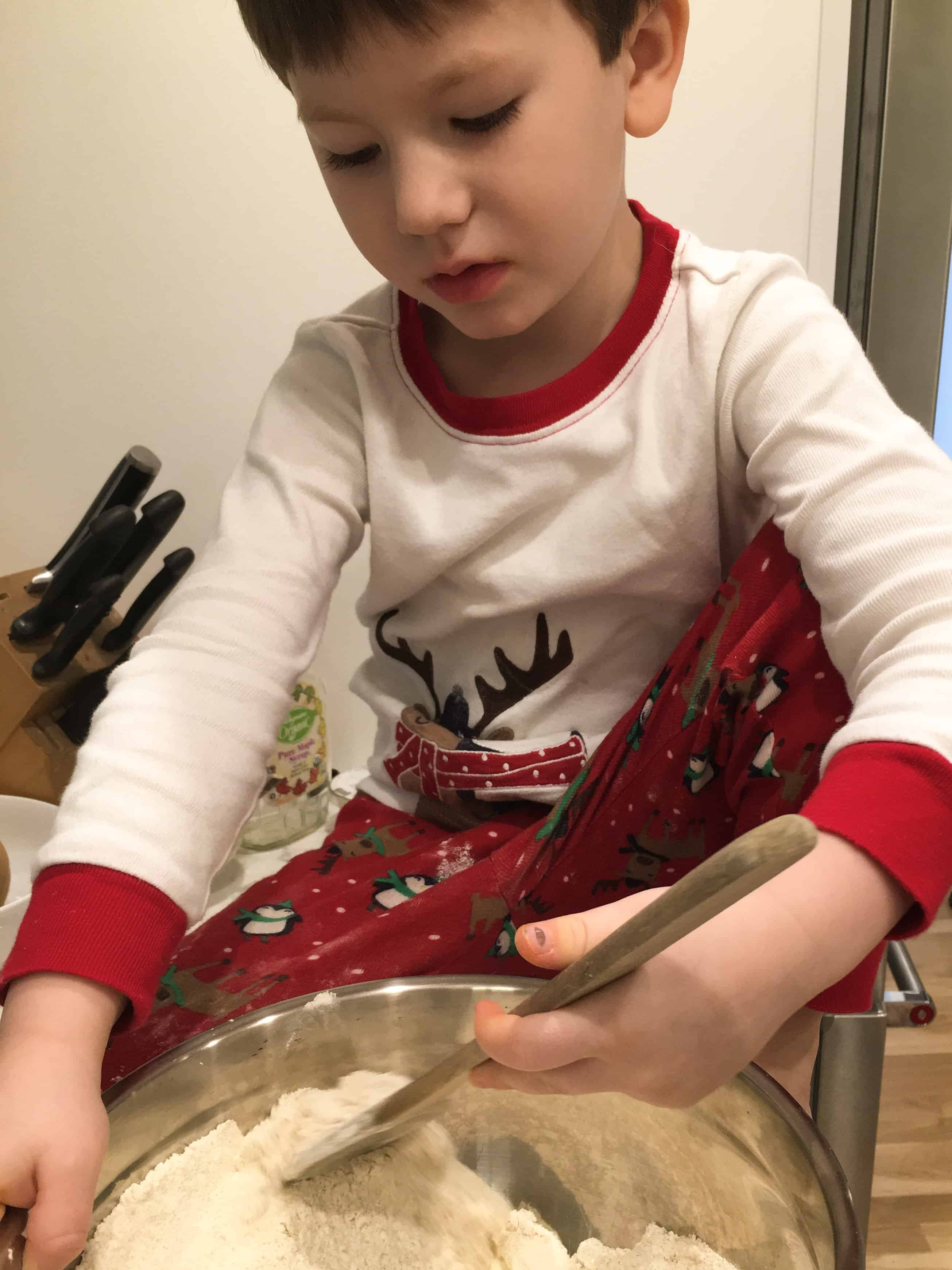 boy mixing dry ingredients in a bowl