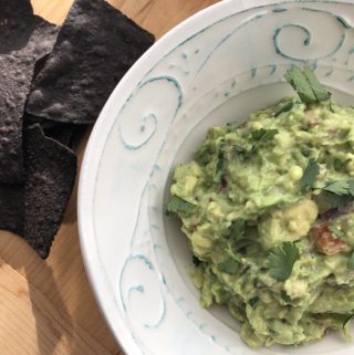 top down shot of Easy Homemade Guacamole in a bowl
