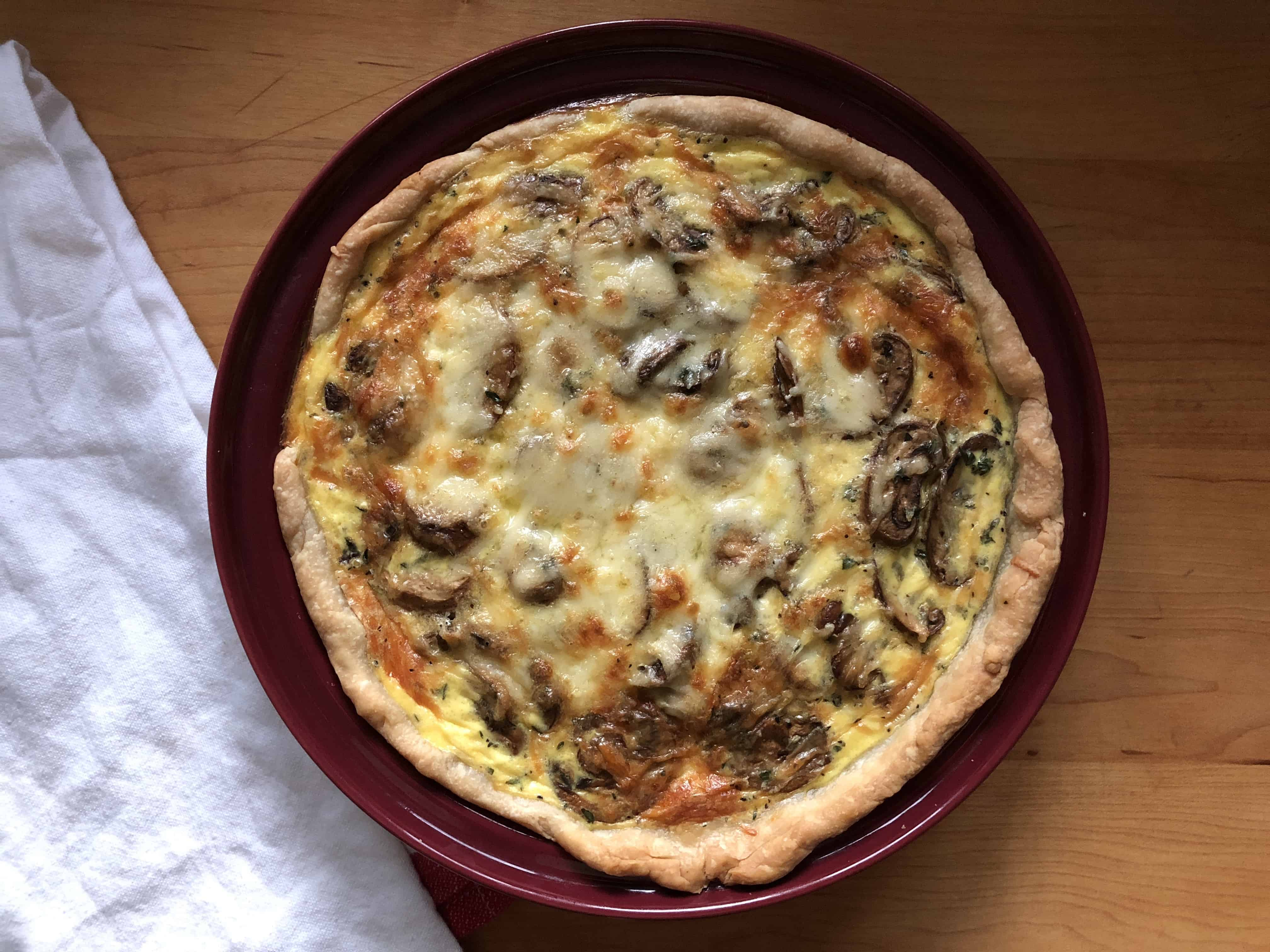 top down shot of Mushroom and Gruyere Quiche on a plate