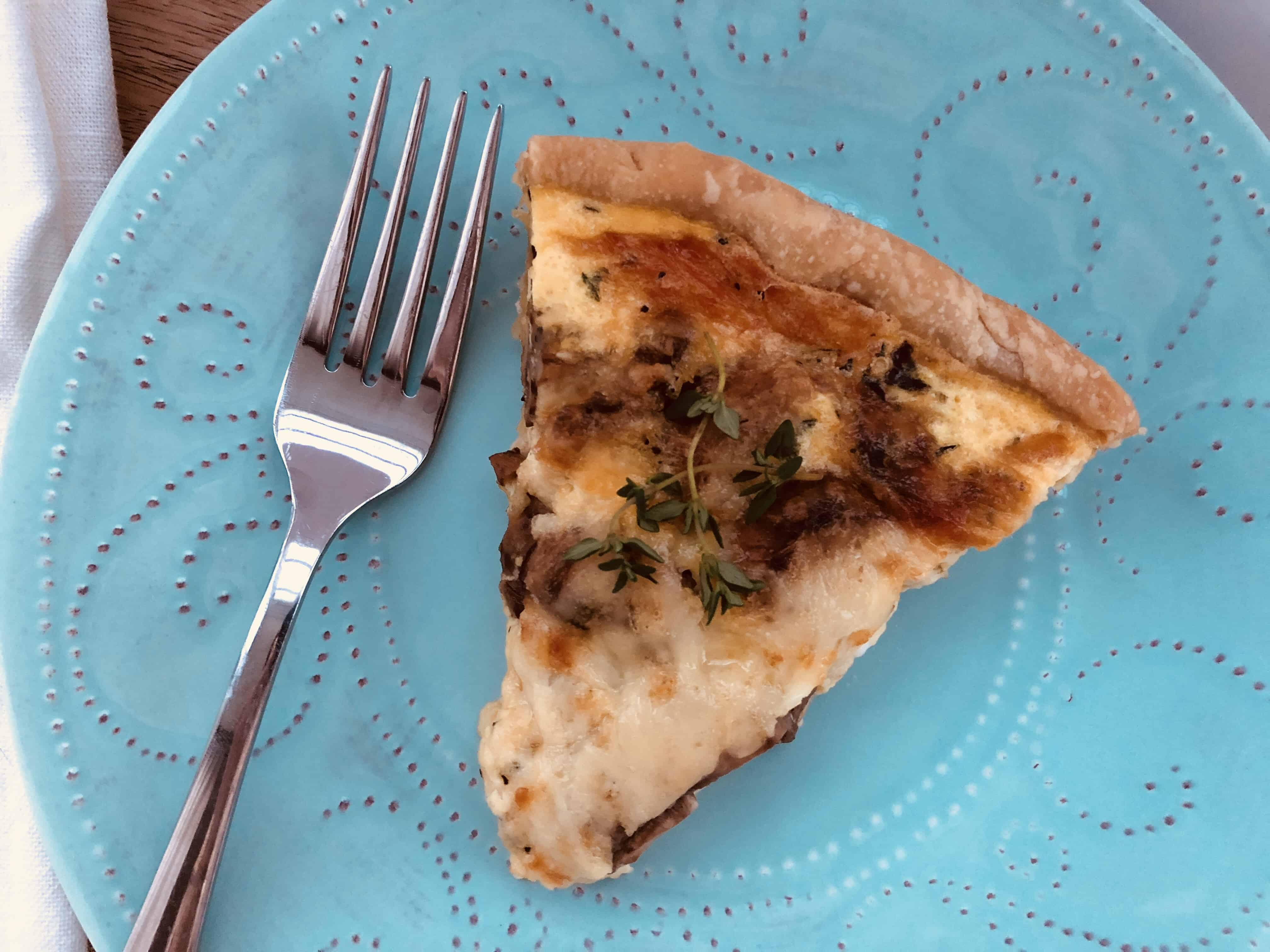 slice of Mushroom and Gruyere Quiche on a plate