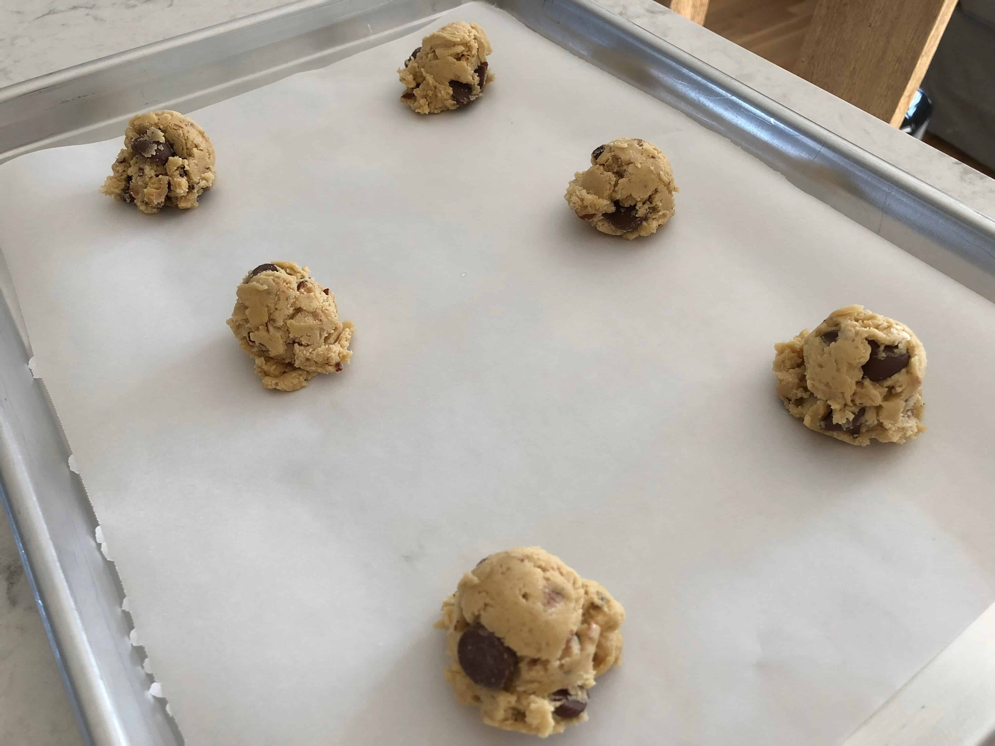 scoops of cookie dough on a pan