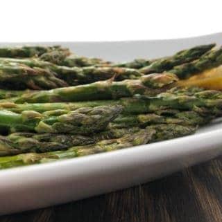 lemon roasted asparagus on serving platter