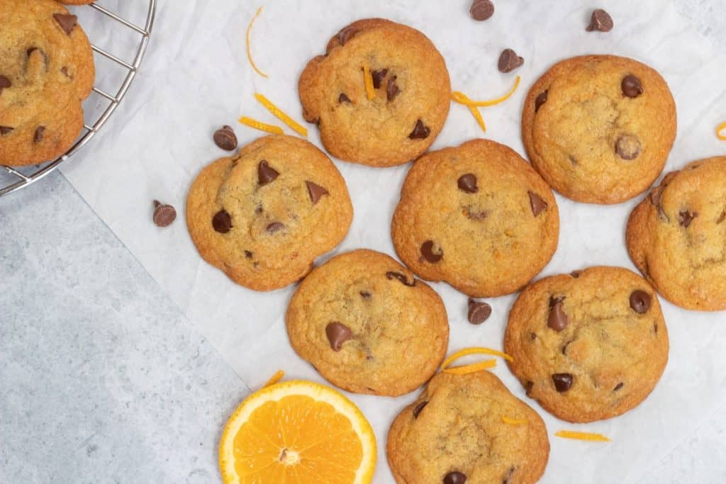 orange chocolate chip cookies on parchment paper