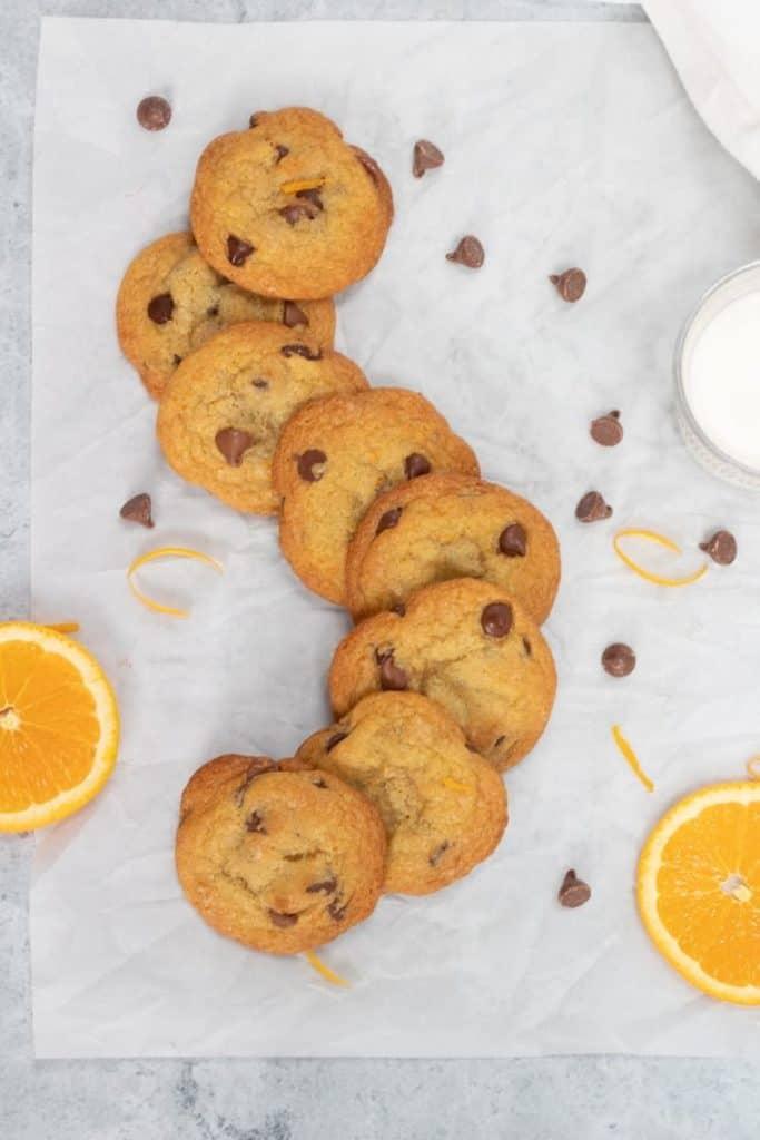 best orange chocolate chip cookies on board with glass of milk
