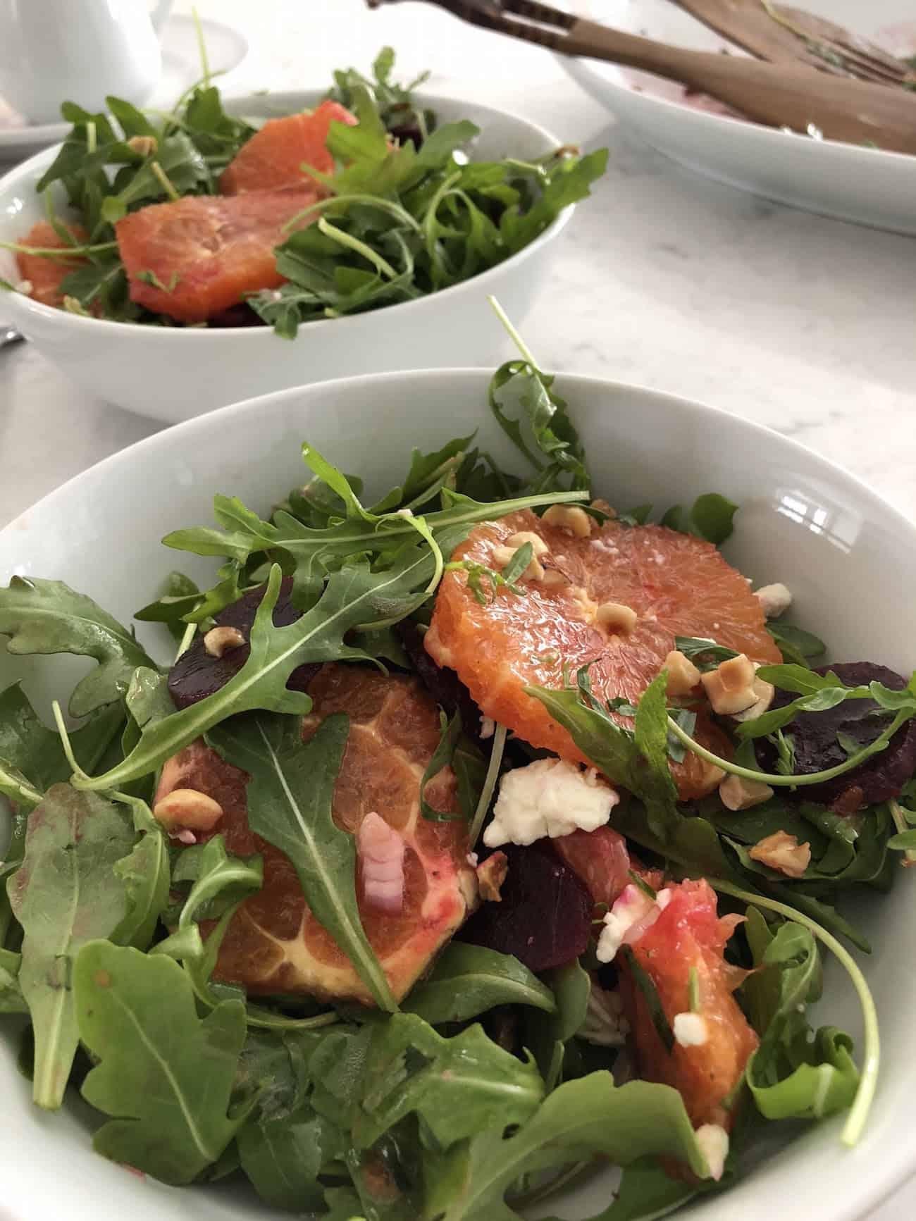 Blood Orange and Beet Salad with Hazelnut Citrus Vinaigrette in two bowls
