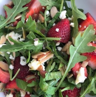 up close strawberry salad in white bowl verticalJPG
