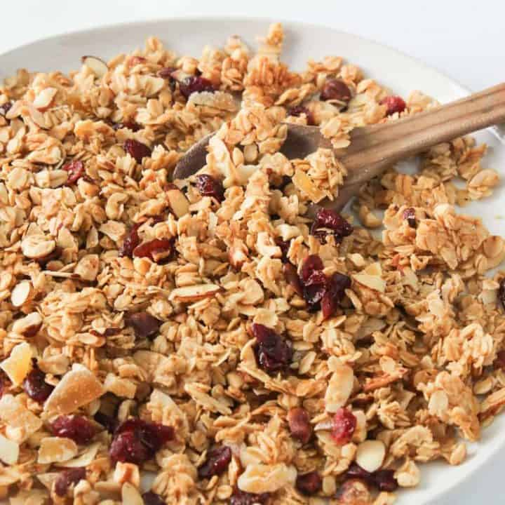 ginger cranberry granola on a white plate
