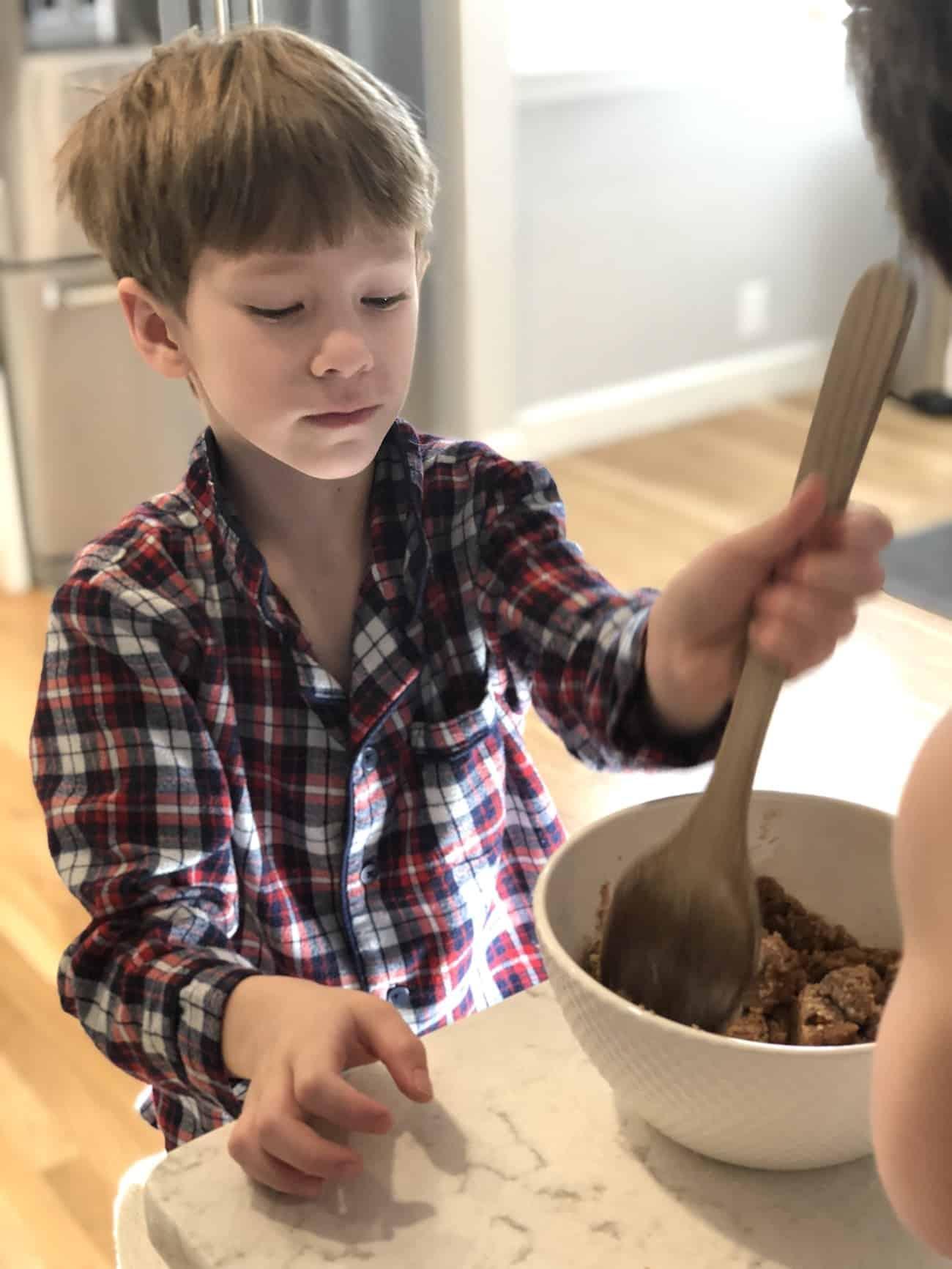 boy stirring in the kitchen