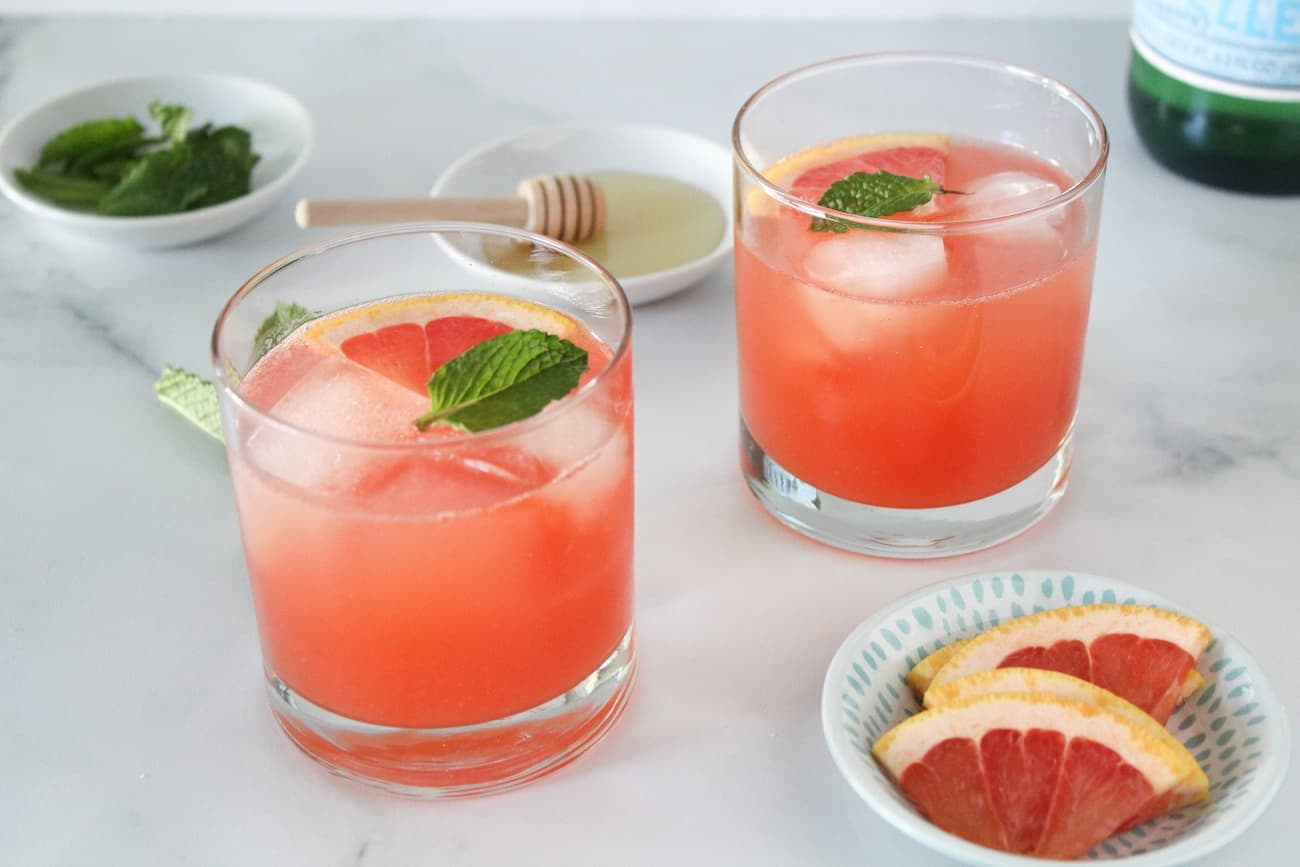 two Sparkling Ruby Red Grapefruit Cocktails on a table