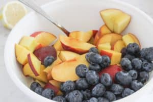 bowl of blueberries and peaches