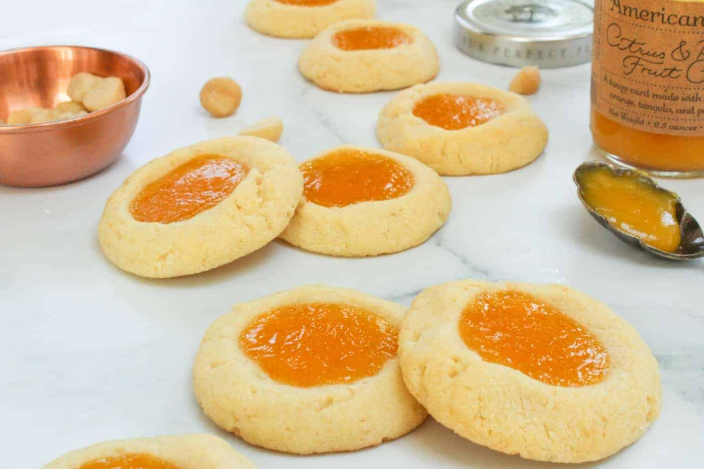 Macadamia Nut Thumbprint Cookies with Citrus and Passion Fruit Curd on a counter top