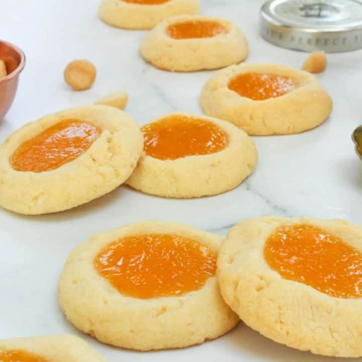 a batch of Macadamia Nut Thumbprint Cookies with Citrus and Passion Fruit Curd