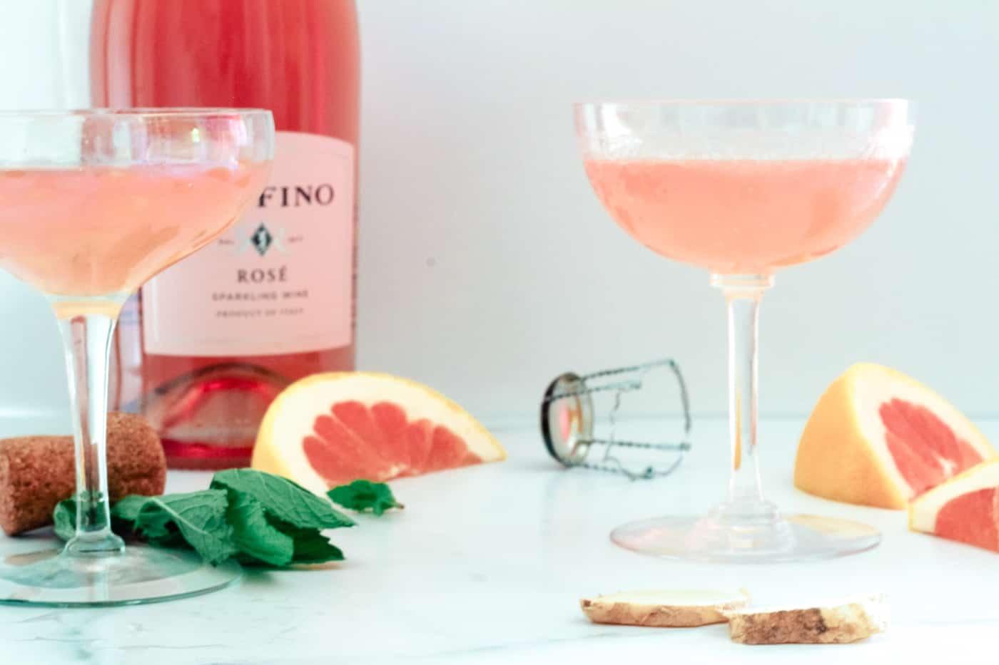 two Grapefruit Ginger Mimosas in long stem glasses