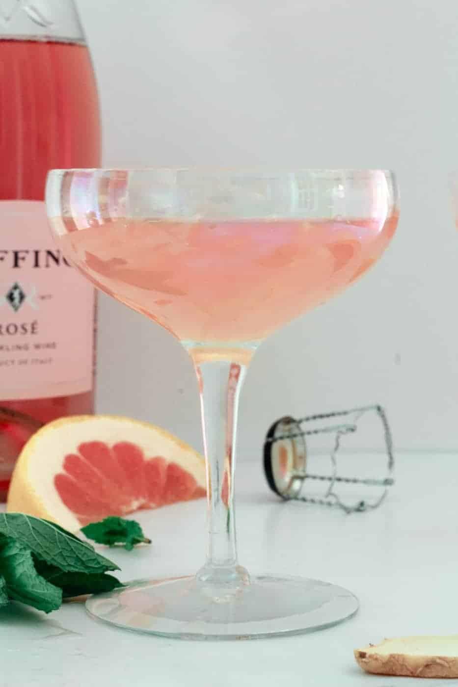 side shot of Grapefruit Ginger Mimosa in a long stem glass