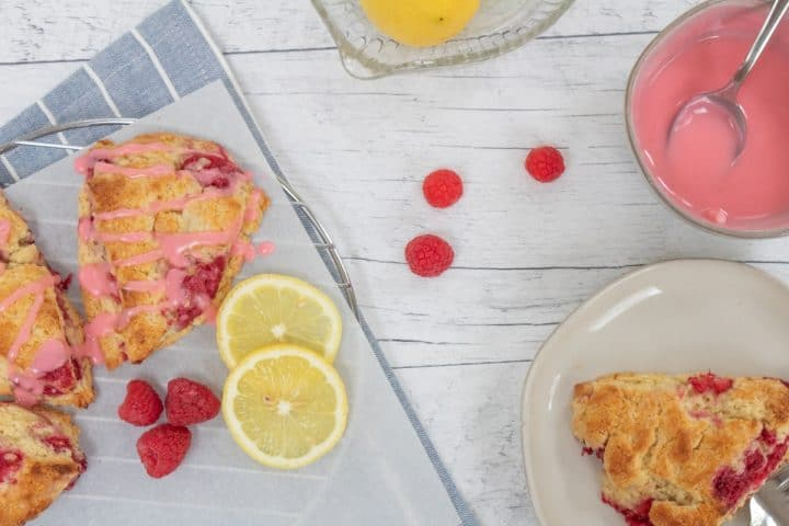 raspberry lemonade scones with glaze on white board