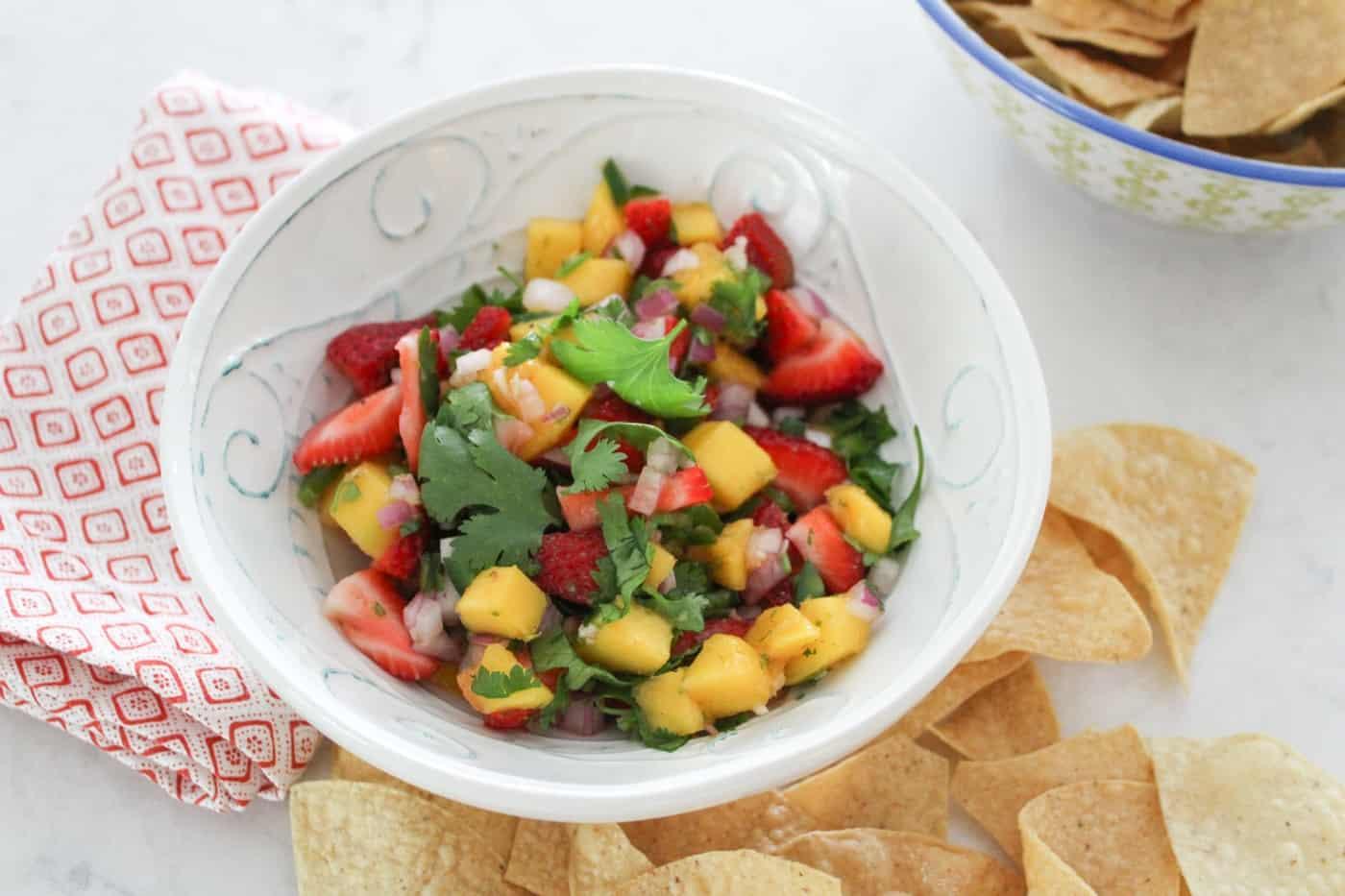 a bowl of mango strawberry salsa