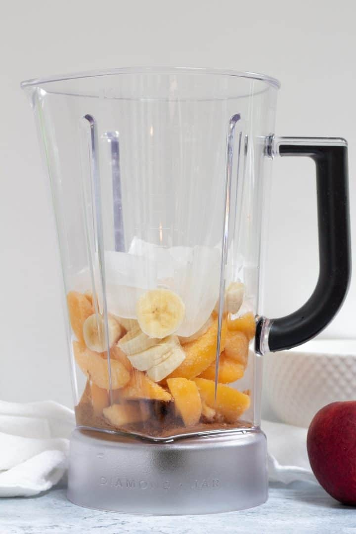ingredients for almond peach smoothie in blender