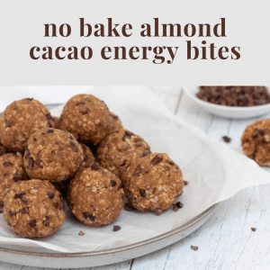no bake almond cacao energy bites on plate with parchment paper