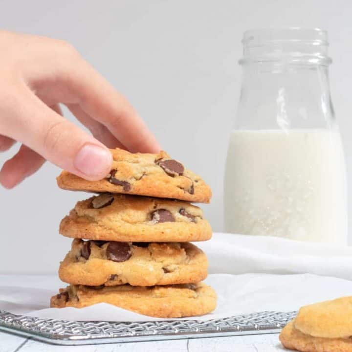 classic chocolate chip cookies with hand taking one