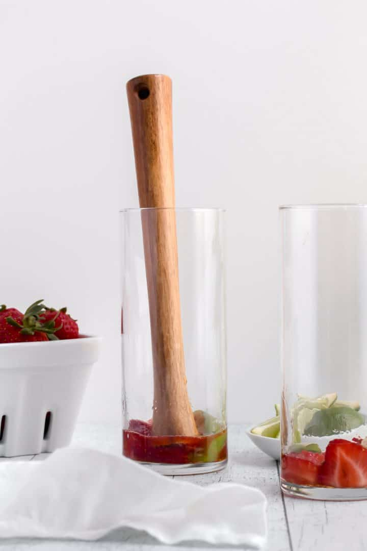 muddle fruit for strawberry mojito