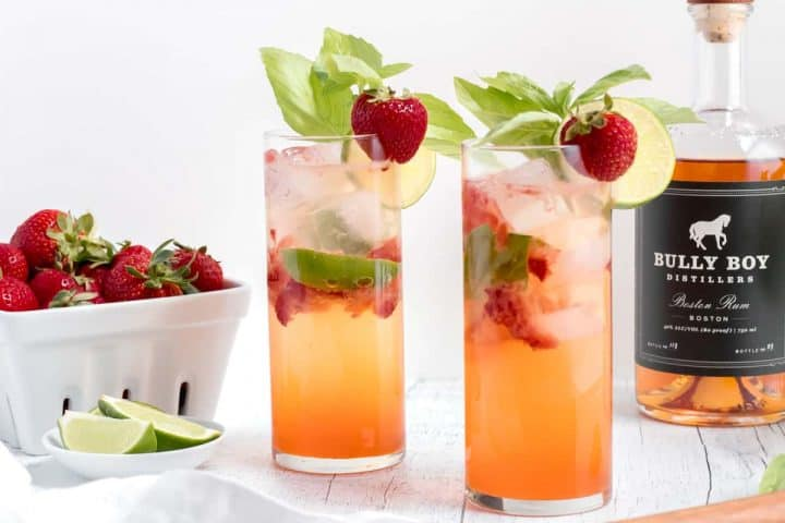 strawberry basil mojitos with bottle of rum