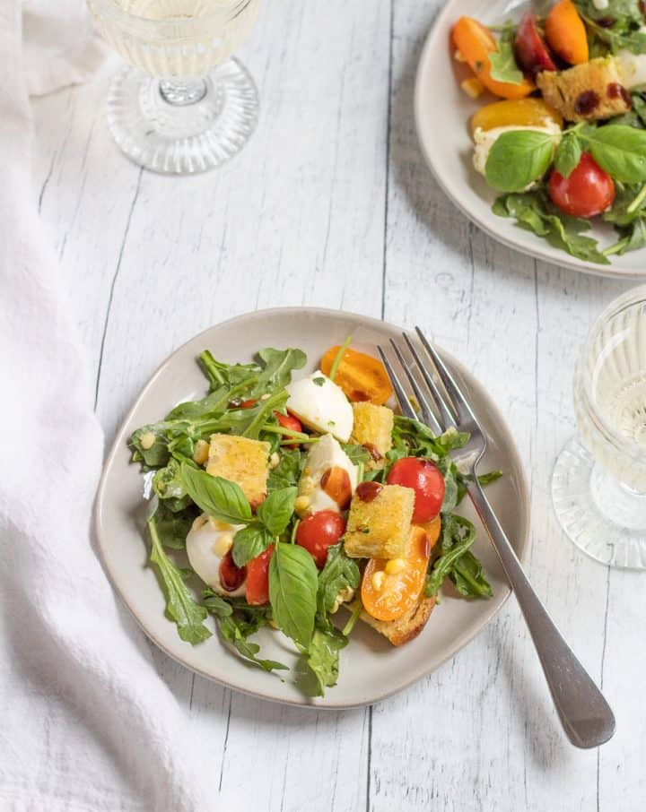 summer panzanella salad with balsamic glaze and glass of wine