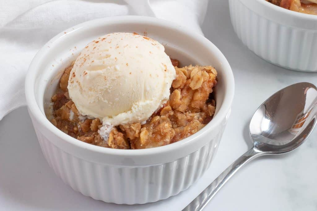 bowl of apple crisp with ice cream