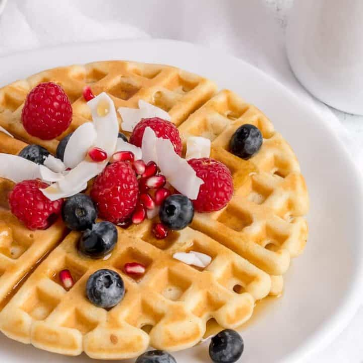 gluten free waffles on white plate with fork
