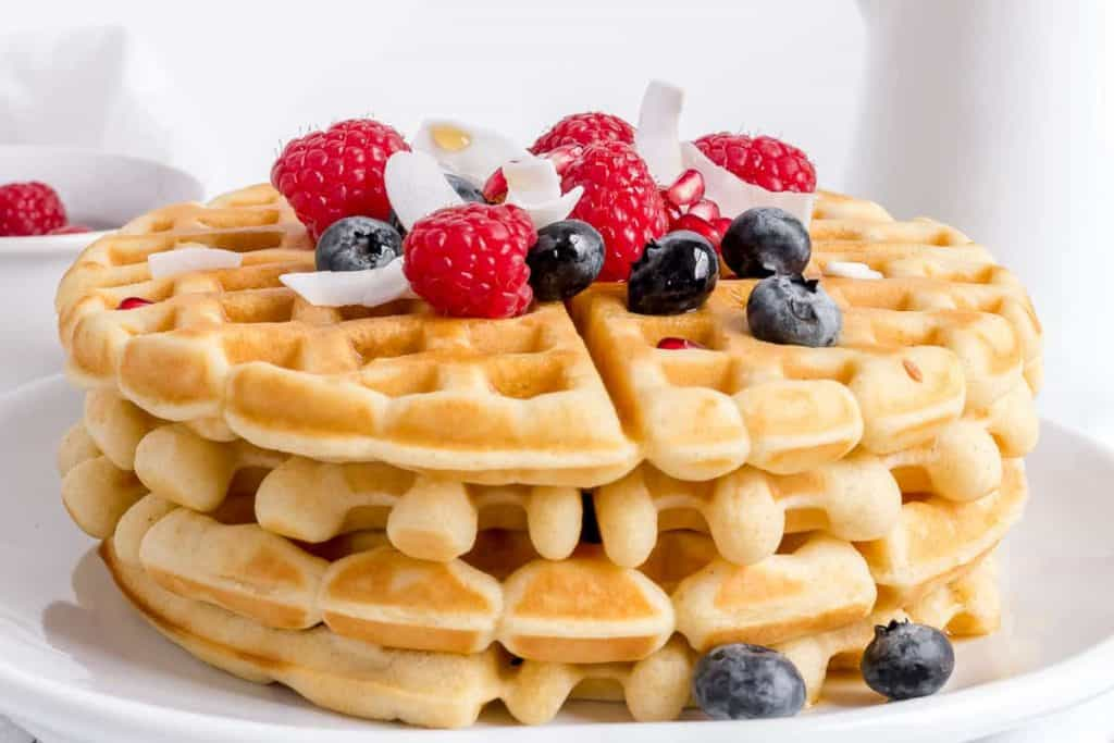 plate of gluten free waffles with berries