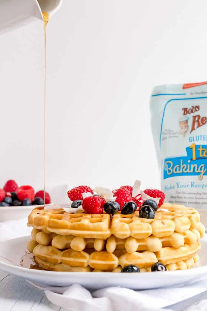 pouring syrup on best gluten free waffles